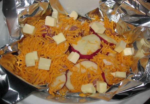 Butter on top of Bacon, Cheese, Potatoes for for Bacon Cheese Potatoes from Walking on Sunshine Recipes
