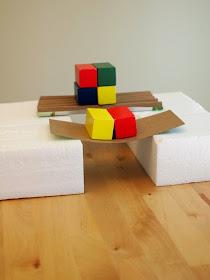 testing out different cardboard bridge's strength (kid engineering)