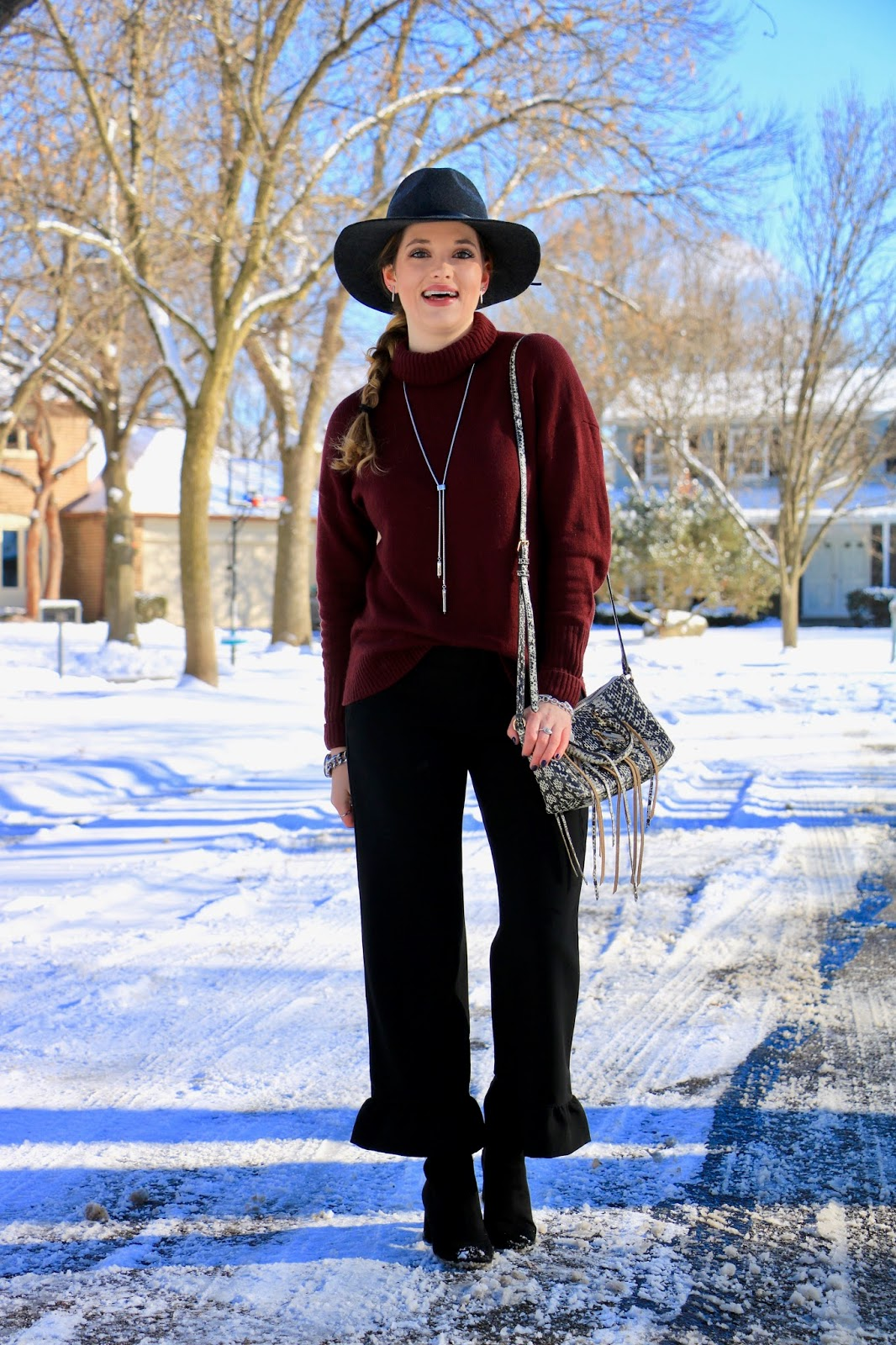 Nyc fashion blogger Kathleen Harper showing how to wear ruffle-hem pants