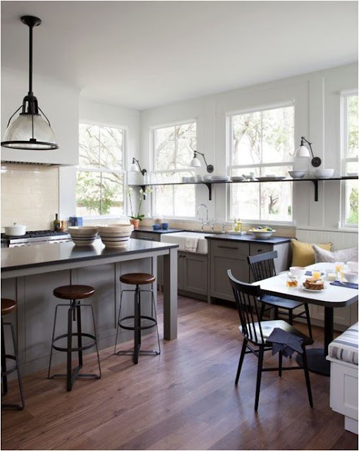 Stunning modern farmhouse kitchen with island and round stools found on Hello Lovely
