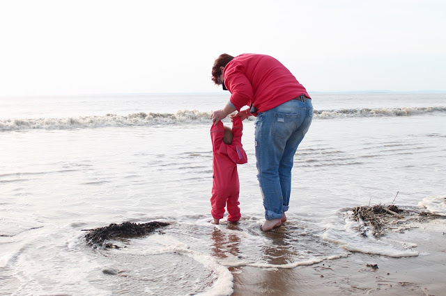 baby girl pink puddle suit for paddling at beach