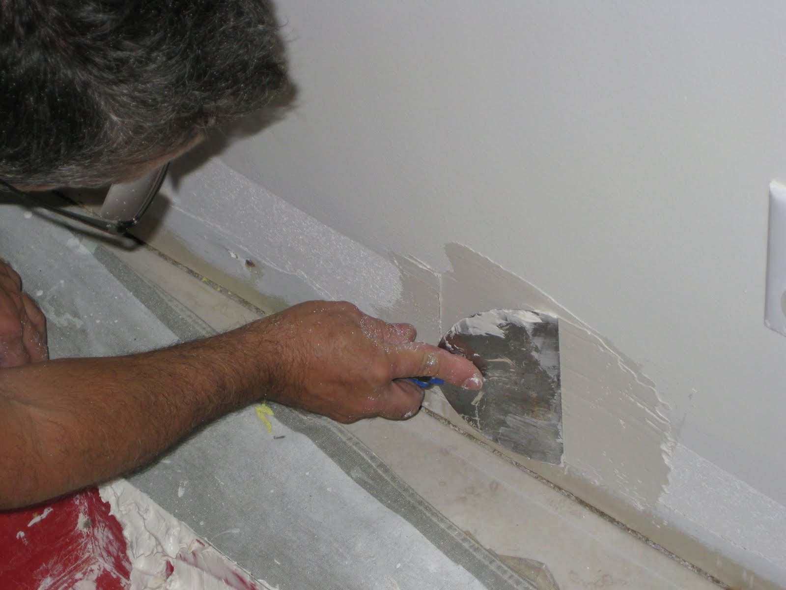 drywall paper repair Learn to patch and repair drywall fit the gypsum into the new hole and press the paper edges coated with joint compound into place along the.