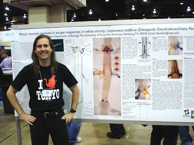 Presenter, Zen Faulkes, in front of a poster.
