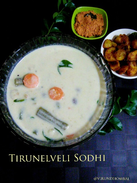 Sodhi is one of Tirunelveli's traditional and popular kuzhambu.This kuzhambu is a special menu on the next day of marriage. A Tirunelveli wedding meal would not be complete without this Sodhi, potato poriyal and ginger chutney.  It is prepared with coconut milk, moong dal, drumsticks, carrots, potatoes and plenty of aromatics like ginger, garlic, green chillies, small onions and lemon juice. The freshly extracted coconut milk gives you the perfect taste for this kuzhambu. We prepare this kuzhambu often during weekends, family get togethers and special occasions. My Mom, Grandma and Athai are experts in preparing this Sodhi.