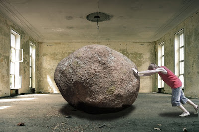 person pushing boulder image