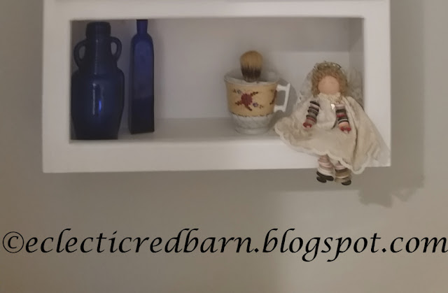 Eclectic Red Barn: Bottom of cabinet with decor