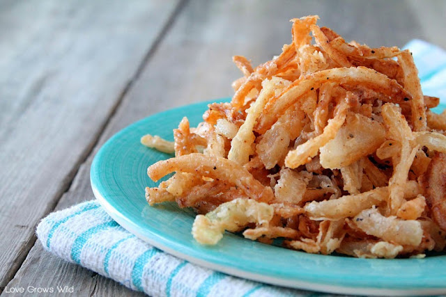 Homemade Crispy Onion Strings - skip the store-bought can of fried onions and make your own with this easy and delicious recipe! Perfect for casseroles, burgers, salads, and more!