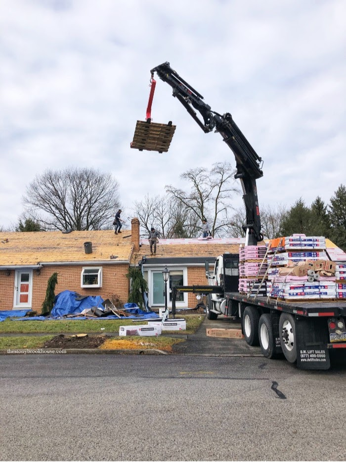 Lifting shingles onto the roof with crane 10am