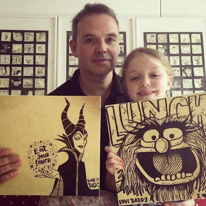 Un padre intenta que su hija coma el almuerzo haciéndole dibujos