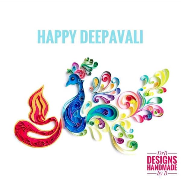 quilled on-edge Diwali paper design of flame and peacock