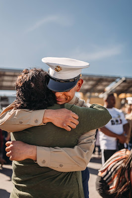 Marine hugging mom after graduation boot camp from MCRD SD