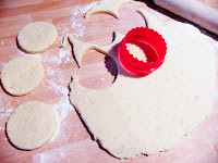tattie scone dough rolled out and cut with a cookie cutter