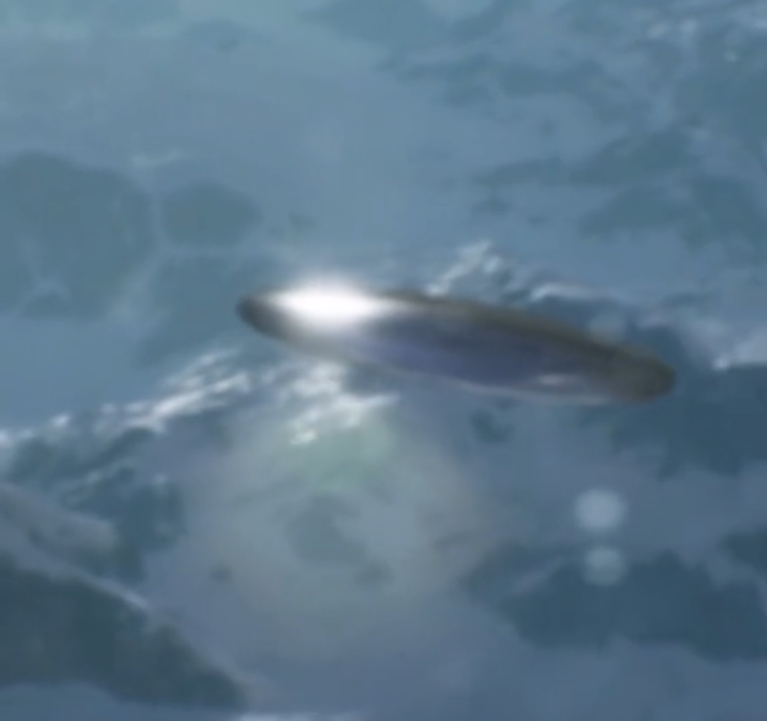 Massive Flying Saucer Flies Underneath A Plane While Eye Witness Films It