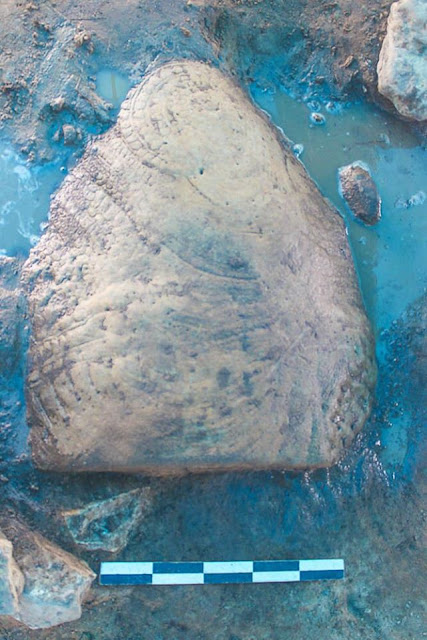 Carved stone turtle unearthed from Angkor reservoir site
