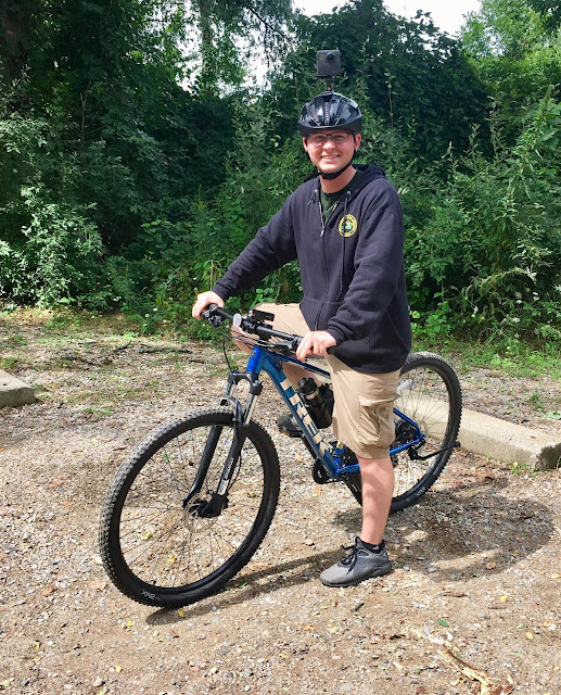 Story author Brad Parsons in a still from the DTE Energy Foundation Trail video he produced for the Michigan Department of Natural Resources. - - Mountain Biking