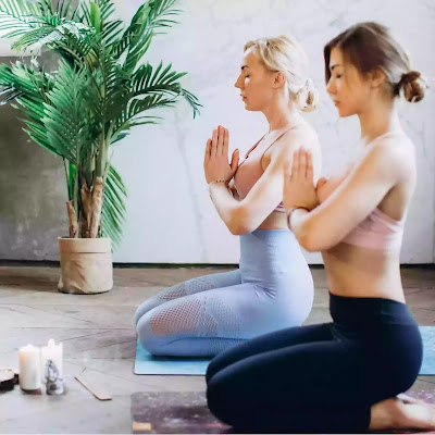 girls practicing vajrasana yoga asana