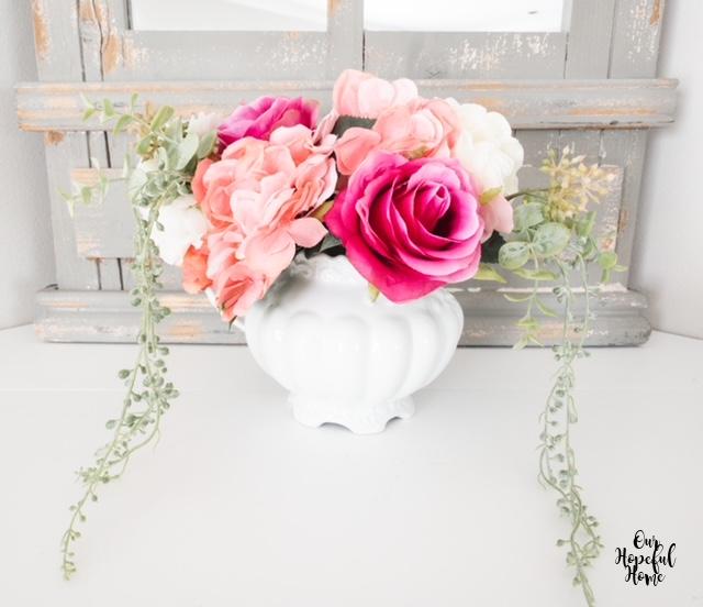 spring floral bouquet trailing greens white pitcher vase
