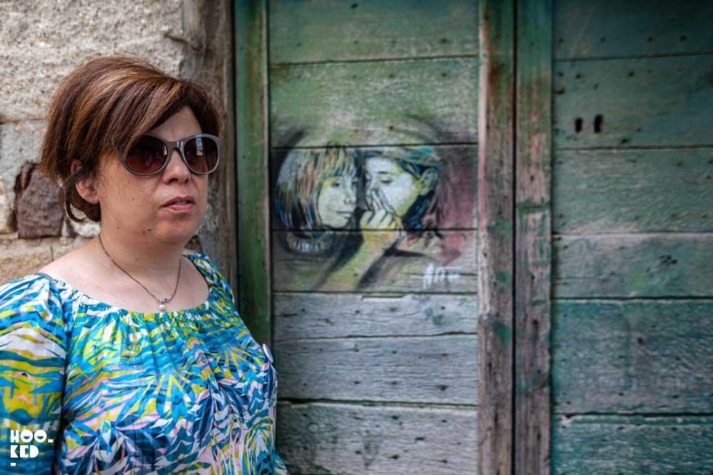CivitArt Cultural Association, Barbara Manuele in front of work by Italian Street Artist Alice Pasquini