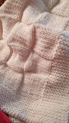 hand knit baby blanket in a checkerboard pattern