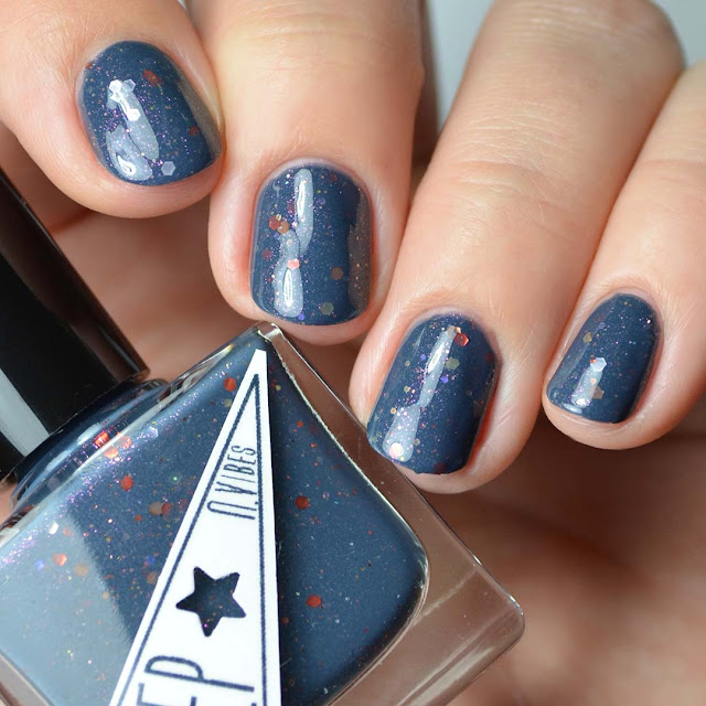 navy nail polish with red glitter