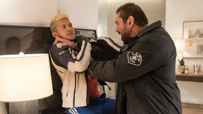 "Movie still for the 2019 film ""Stuber"" where Dave Bautista strangles Iko Uwais in a hotel room"