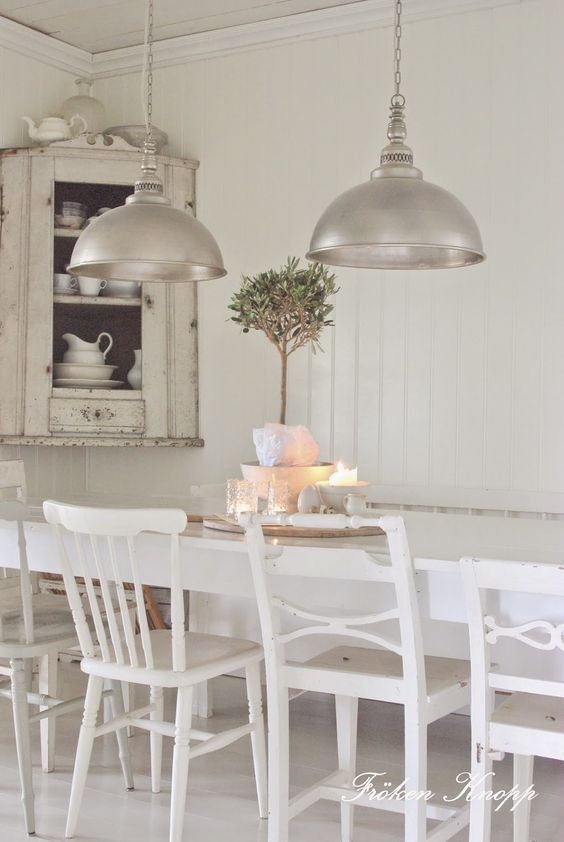 White mismatched dining chairs painted white in Swedish style room - found on Hello Lovely Studio