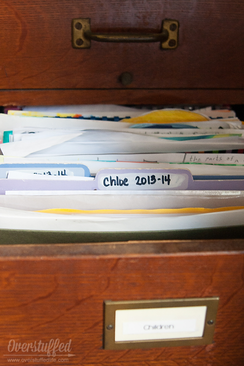 File the papers your child wants to keep by school year.