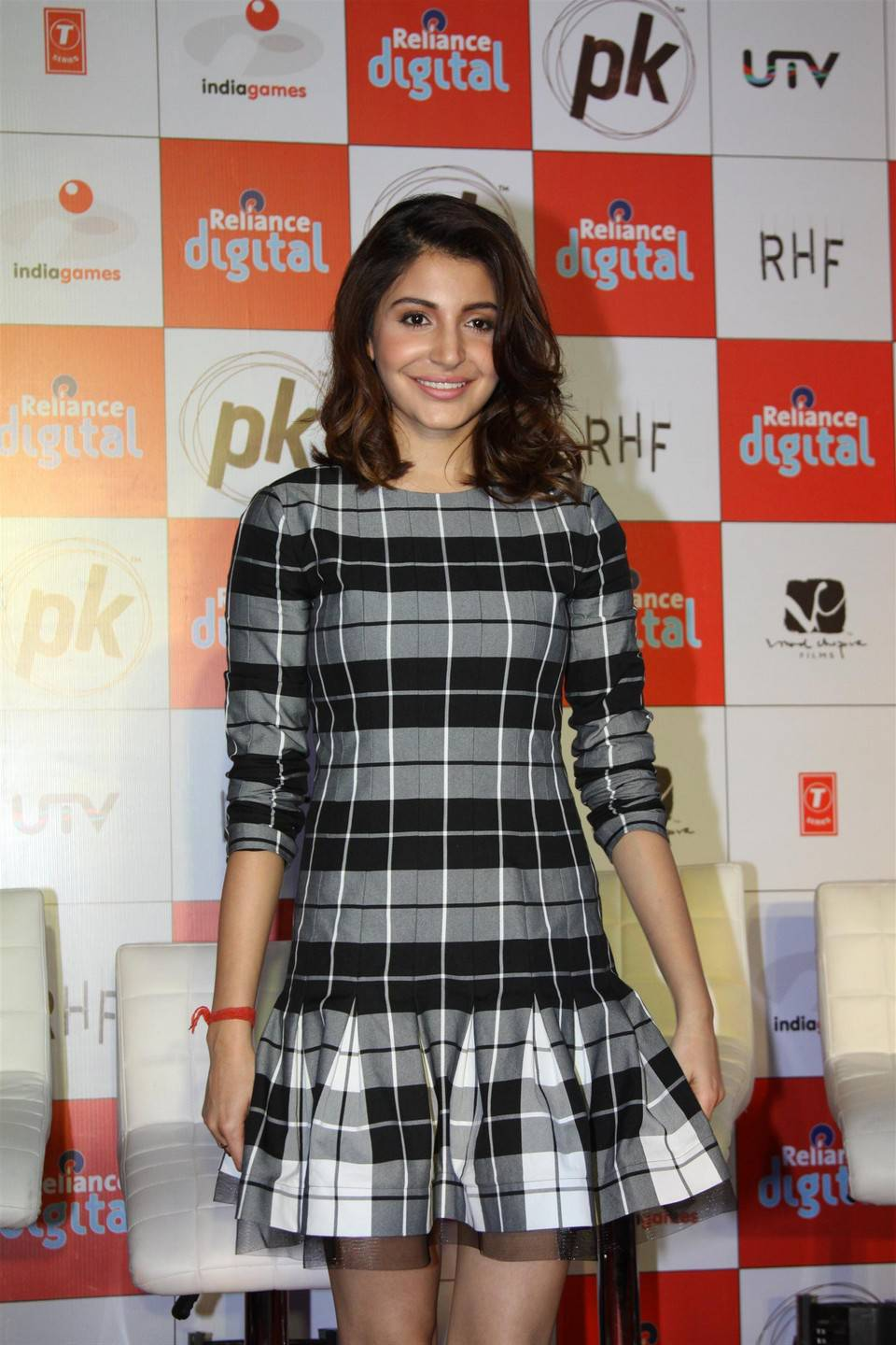 Hindi Actress Anushka Sharma In Short Black Dress At Movie Launch