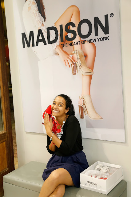 Kriya Gangiah tries on a pair of stunning shoes at Madison The Heart of New York