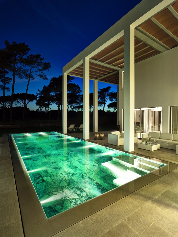 Swimming pool of Simple modern home in Portugal at night