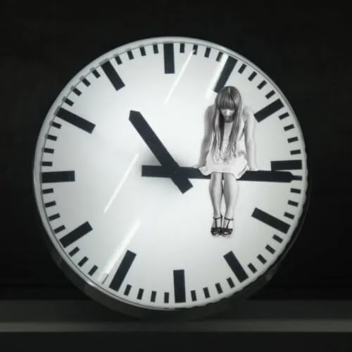 sad girl sitting on clock DP for girls