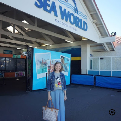 awayfromblue Instagram | seaworld double denim chambray maxi skirt and graphic tee outfit with louis vuitton neverfull