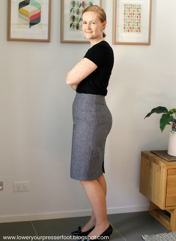 picture of a woman wearing a grey skirt