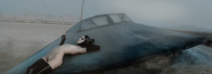 Surreal flying wing nude photo by Eugenio Recuenco.