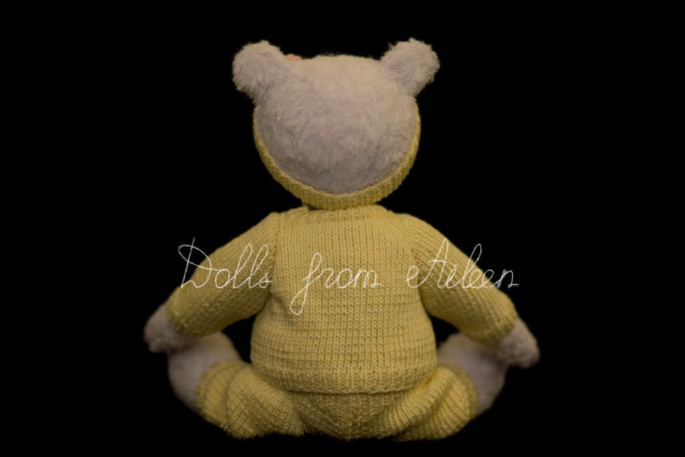 ooak artist teddy bear sitting wearing sporty outfit, view from behind