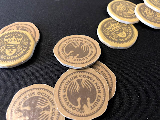 The sturdy coin tokens used to buy gear in Caper.