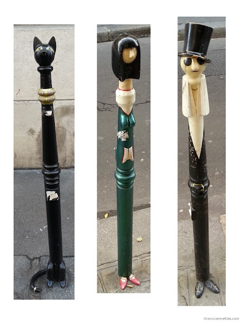 Paris street art decorated traffic control black metal poles