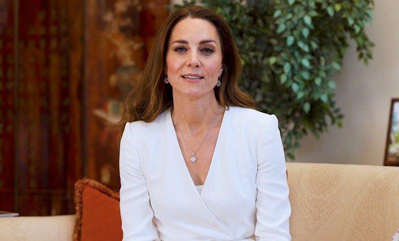 Kate Middleton wore an peplum dress coat from Alexander McQueen. Mappin and Webb empress earrings