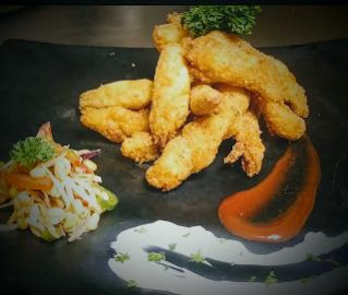 Garnished fish fingers with tartar sauce for fish finger recipe