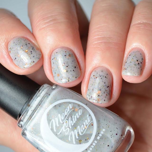 grey glitter nail polish four finger swatch
