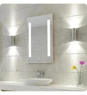 A smart bathroom mirror on the wall of a gray bathroom.