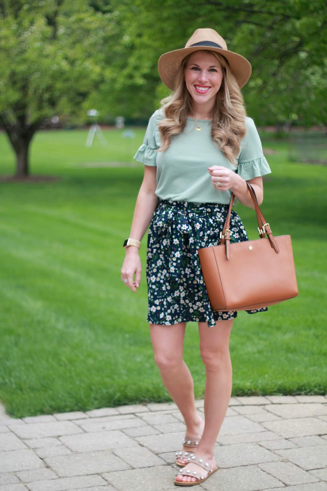spring trend review, spring trends, pink striped jumpsuit, blush tennis shoes, snakeskin blouse, snakeskin wedges, mint tunic, blue floral paper bag skirt, green ruffle top, camo tee, pink jacket,