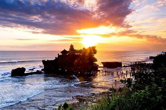 Admire the beautiful sunset at Tanah Lot Temple