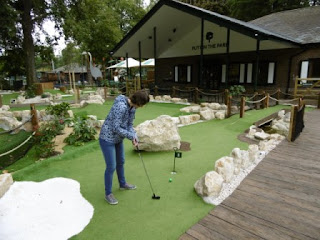 Emily playing the Putt in the Park mini golf course in Battersea Park, London on Miniature Golf Day 2015