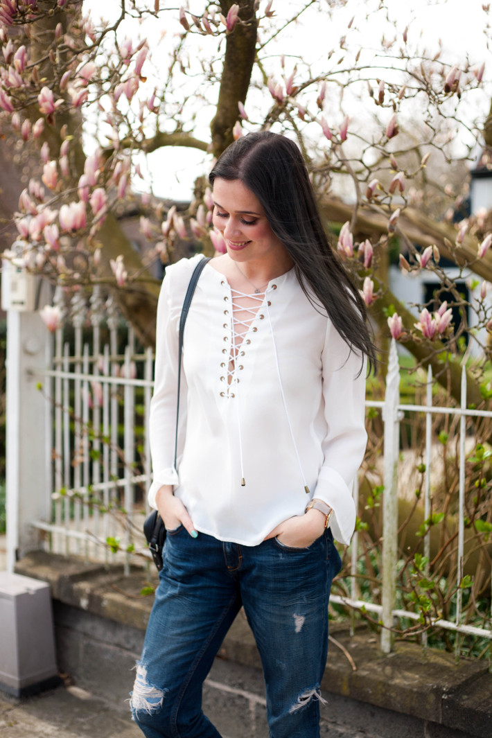 outfit: lace up blouse, boyfriend jeans