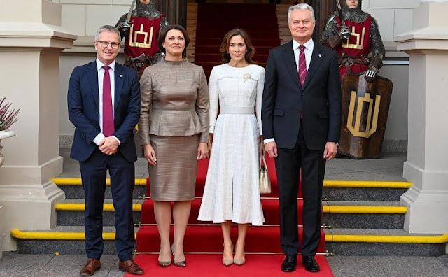Lithuania's President, Gitanas Nauseda, and his wife, Diana Nausediene. Crown Princess Mary wore a tweed dress