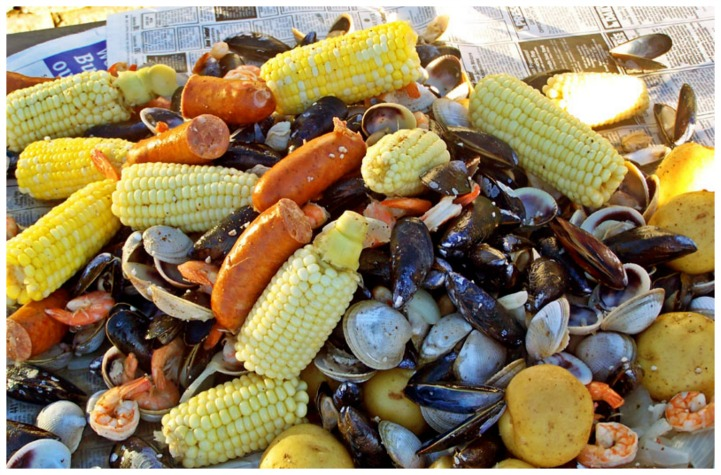 Coastal clam bake with clams and corn