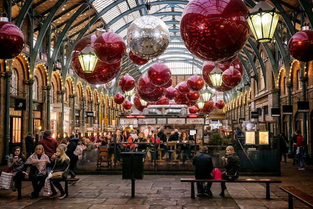A really pretty picture of Christmas decorations hanging in Covent Garden market building