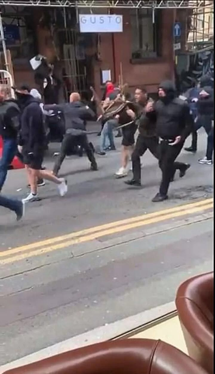 Manchester United and Leeds fans involved in violent clashes in city centre
