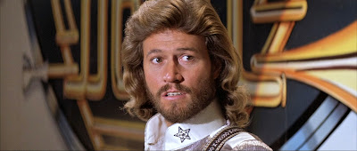 Sir Barry Gibb as Mark Henderson